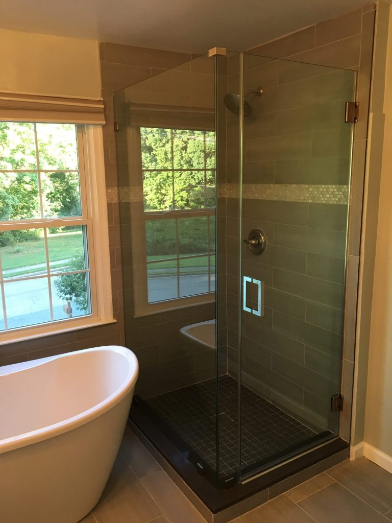 Bathroom remodel with frameless glass shower