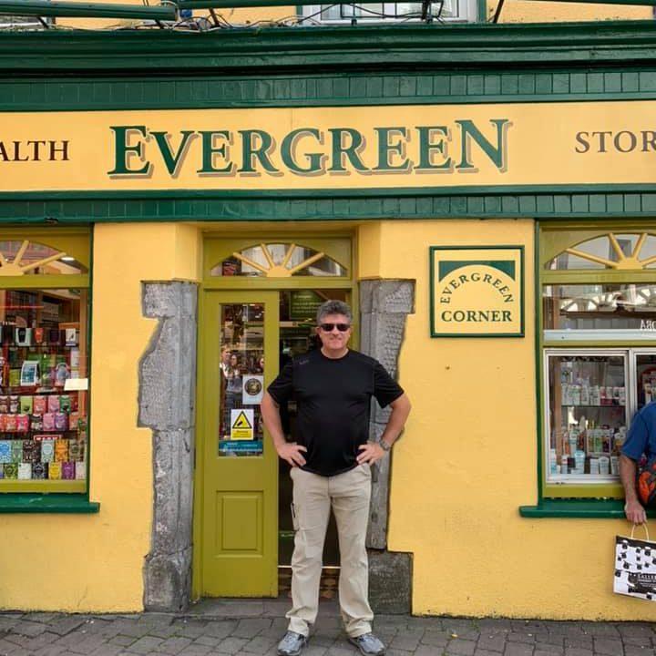 David Guerin in front of Evergreen corner store